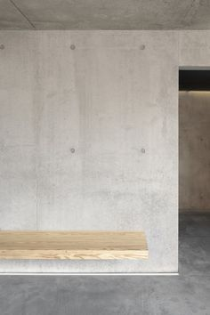 Concrete wall with wooden seat. The Kamppi Chapel by K2S Architects. Nice.