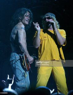 Eddie Van Halen and Sammy Hagar during Van Halen in Concert - June 22, 2004 at Continental Arena in East Rutherford, New Jersey, United States.