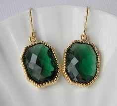 Big, green earrings