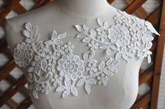 Pretty, but it takes a little bit of imagination to see how it would actually go - I would have it curve down over the chest - so, general placement like the one on the left, but upside-down. lace applique white lace fabric applique crochet lace by QFabrics, $4.99