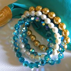 DesigningCrystal.com ::: Dazzling #Bracelet Four-in-One;  #Swarovski crystals in Teal & Gold pearl with freshwater #pearls #jewelry