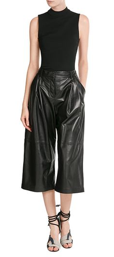 Nothing says statement like a pair of McQ Alexander McQueen's black leather culottes. Cropped to show off streamlined ankles, the combination of a voluminous silhouette and fitted waist make them flattering, comfortable and full of fashion impact #Stylebop
