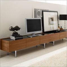 "Horizon Media Center available in walnut finish with option black, coffe or extra white glass top.  2 Lateral drawers and central drop down door with glass shelf and hole in the back of the cabinet allowing for cable management.  Rectangular chrome metal base.  70.75"" w x19.75"" d x 19.5"" H  Available at POMP HOME in Culver City, CA  www.pomphome.com"
