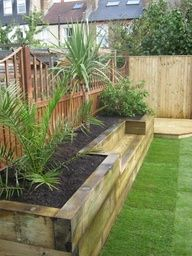I think this is a great way to turn a raised bed into a multi-use item. Extra backyard seating is always good and being able to sit among the plants a plus. - Bench & raised bed made of railway sleepers