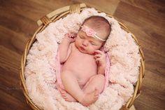 Newborn baby girl with pink headband sleeping in a basket, unique fine art baby photos by Olga Klofac Professional Baby & Child Photographer Charlestown Mayo  www.mayophotographer.ie www.facebook.com/olgaklofacphotography