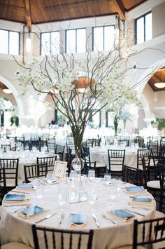 Tall arrangements give your wedding tables a big statement but they also allow for conversation among your seated guests.