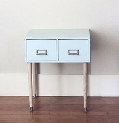 Reuse & Recycle: 5 DIY Metal Side Table MakeoversThe Paper Mama found a bargain priced filing cabinet at a thrift shop. Once she brought it home, she decided to turn it into a side table where she could store her ribbons and tapes. She gave it a fresh coat of paint, cut down some wooden table legs she purchased at Lowe's, and screwed the legs into the inside of the cabinet. Find the full tutorial here.