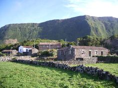 Aldeia de Cuada in Flores Island in the Azores.  The stone huts indicate that this is one of the islan'd oldest towns.  It is thought that the Portuguese knew about the Azores by mid-1400, but settlement began some 150 years later.  The eastern islands were the first to be used as supply stops for Portuguese exploration.