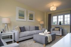 A light and spacious family room is perfect for relaxing together. Tripod lamps are the statement accessory here and add a metallic finish to the space.