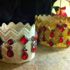 I started out thinking birthday crowns for the kids in my class, then I thought birthday party crowns, then, wearing for Reader's Theater, a little girl's room decoration . Anymore ideas? Aren't they beautiful?