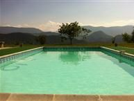 Private swimming pool with a brilliant view of the surrounding mountains - the perfect holiday getaway. http://www.holidaylettings.co.uk/languedoc-roussillon/