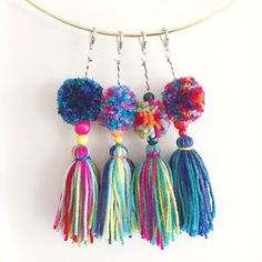 Need something bright and colorful to dress-up that boring old bag? See this DIY tutorial to make your own pom pom and tassel keychains!