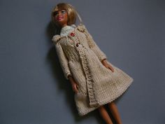 Lots of Free doll clothes patterns here - http://barbiebasics.tripod.com/knits.html    Ravelry: Knit Coat pattern by Lynne Sears