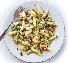 Stir roasted cauliflower, hazelnuts, eggs, double cream and thyme into penne pasta for a vegetarian version of the classic carbonara