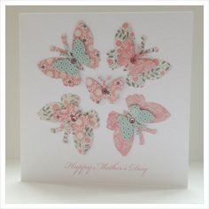 Beautiful Butterflies Handmade Greeting Card for Mother's Day ... luv the paste printed papers used to punch the butterflies ... pretty pattern with four in a circle ... delightul!!