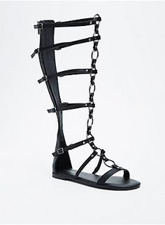 """The kind of sandal that'll dominate your shoe collection. The black faux leather knee-high gladiator sandals are totally naughty by nature with hematite O-rings detailing the adjustable cage straps.<div><ul><li style=""""list-style-position: inside !important; list-style-type: disc !important"""">TRUE WIDE WIDTH: Designed so you never have to size up again. For the perfect fit, we recommend going down a whole size.</li><li style=""""list-style-position: inside !important; list-style-type: disc…"""