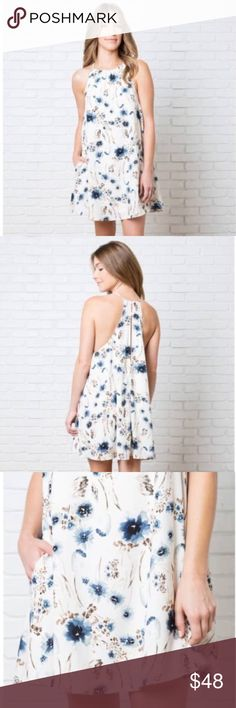 "🆕Beautiful floral print dress💕 Flowy dress designed with a trapeze silhouette. Patterned with a painterly floral print in blue, black, brown and cream hues. Crafted with a lightweight, silk fabric that features a halter style neckline, dainty shoulder straps, fully lined and is finished with a dramatic back keyhole. Made out of 100% polyester. MEASUREMENTS: length 34"" 💙💕 Dorimas Closet Dresses Midi"