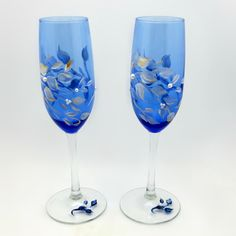 Hand Painted Wine Glasses - Champagne Cobalt Blue Flutes - Windswept White and gold tipped leaves -  with white faux pearls - Wedding. $40.00, via Etsy.  ~SOLD~