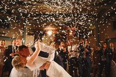 Bride and groom kiss under a confetti cannon shower at their Harrogate wedding.