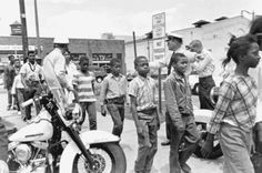 Police lead a group of African-American school children off to jail following their arrest for protesting against racial discrimination in Birmingham, Alabama. May 4,1963.