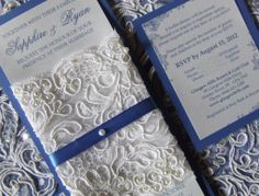 White lace and royal blue color theme for wedding invitations.