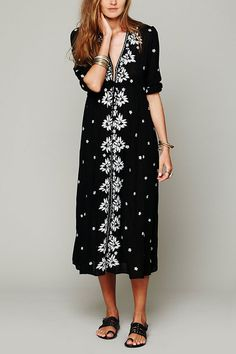 Still looking for a chic maxi dress for your vacation or a party? Then this floral embroidered maxi dres is here for you. The folk embroidered pattern on it makes you conspicuous. It also features plunging V-neck, drawstring waist, lovely three quarters bubble sleeves and elasticized sleeve openings. Team it up with a pair of sandals as well as some metallic accessories would make you look perfect.