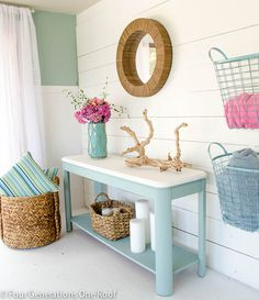 look at the blue baskets on the walls and consider them for your laundry room. I believe they are purchased at home goods.