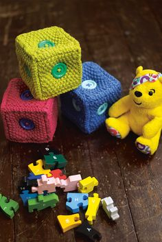 Soft and fun knitted square brick toys in bright colours. Shop this knitting pattern now at The Knitting Network