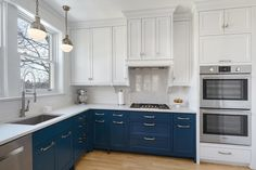 Painted lower cabinets with everything white and stainless above.