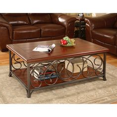 @Overstock - Enhance your home decor with this scrolled metal and wood coffee table Elegant accent table features detailed metal scrolls on long sides of table Sturdy table is supported by a fashionable metal frame and legshttp://www.overstock.com/Home-Garden/Scrolled-Metal-and-Wood-Coffee-Table/2536112/product.html?CID=214117 $252.99