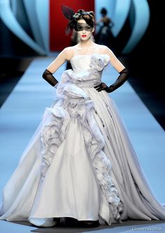 Christian Dior Spring/Summer 2011 couture collection is dripping with opulent, old school glamour. As usual, we fell for the dramatically draped ball gowns in pastel shades.