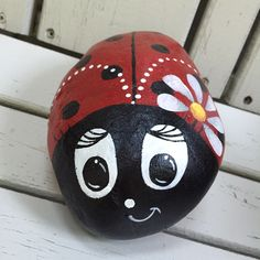 My Cute lady bug rock I painted for a Bday gift.  First attempt at painting a rock!