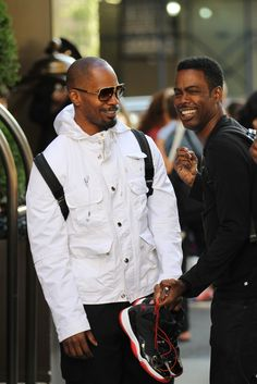 Pals Jamie Foxx and Chris Rock joked around with each other outside the Trump Hotel in New York before parting ways on Aug. 15.
