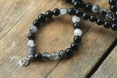 A personal favorite from my Etsy shop https://www.etsy.com/listing/268008522/new-108-beads-black-obsidian-with