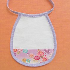 """Cute Baby Bib with Bias Tape - Looking at this more closely, I don't think I'm wild about the """"string tie""""."""
