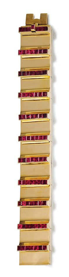 YELLOW GOLD AND RUBY BRACELET, CARTIER,  CIRCA 1936.  The yellow gold articulated band embellished with calibré-cut ruby bars, length approximately 180mm, signed Cartier and numbered, French assay and maker's marks.