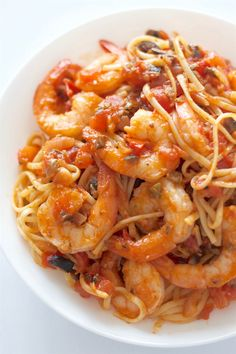 A healthy, fresh tasting Italian pasta that is ready in 30 minutes! Pasta Puttanesca is made with fresh tomatoes, olive oil, capers, olives, anchovies, garlic, and shrimp.