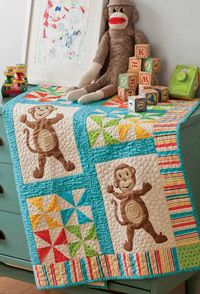 Three little monkeys, jumping on the bed ... Along with pinwheel blocks and a striped border, the monkeys complete this adorable quilt-sized perfectly for a toddler.