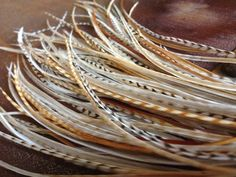Hey, I found this really awesome Etsy listing at http://www.etsy.com/listing/85119367/sale-feather-hair-extension-blonde-cream