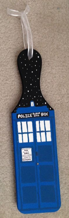 Doctor Who TARDIS paddle i made for my little and my bestie/cousin in my sorority family! (sorry it's blurry!)