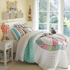 A perfect girl's teen room with a peace sign comforter.  Love the gorgeous windows.