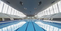 Modern swimming pool design. The London Aquatics centre, iconic modern concrete architecture design by Zaha Hadid for Stratford at the London Olympics. Designs and images featured on Martyn White Designs Interior Design blog. Images courtesy of Hufton + Crow
