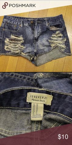 F21 Jean Shorts Forever 21 Jean shorts - size 28- super cute! Floral print pockets on the front Forever 21 Shorts Jean Shorts