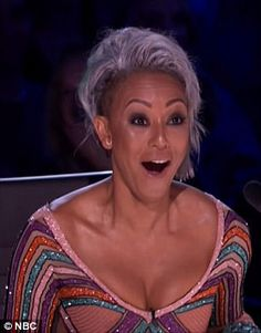 'Angry' Mel B brands Simon Cowell 'stupid' after hurling water at him and storming off America's Got Talent following crude 'wedding night' joke