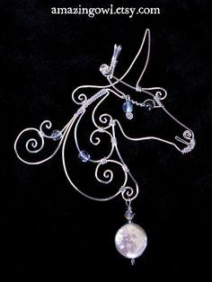 White Unicorn - sterling silver wire pendant. via Etsy.