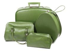 """""""Great retro olive green vinyl luggage set! Go anywhere you want in style with these wonderful pieces. Set includes overnight suitcase, egg-shaped toiletry case, handbag, and makeup bag."""""""