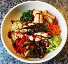 Rice mixed with meat, vegetables, an egg, and chili pepper paste / 비빔밥 / Bibimbap. Gluten Free Korean Dinner Ideas