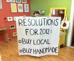 New Year's Resolutions for Buy Local Buy Handmade We just taped old book pages together, and then painted on the resolutions Will you commit to buying local and handmade? Store Window Displays, Shop Displays, Buy Local, Shop Local, Handmade Shop, Craft Fairs, Soy Candles, Burlap, Crafty