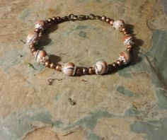 A beautiful chocolate brown marble with silver details, copper beads and a bronze lobster clasp. Handcrafted to bring a smile to your loved ones face. Ideal gift for Mother's Day, birthday or any occasion.  Thank you for your time. | Shop this product here: http://spreesy.com/SpryHandcrafted/48 | Shop all of our products at http://spreesy.com/SpryHandcrafted    | Pinterest selling powered by Spreesy.com