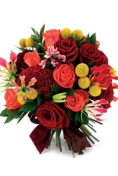 Handtied bouquet of Grand Prix and Wow roses, gloriosa lilies, craspedia, ruscus and celosia,